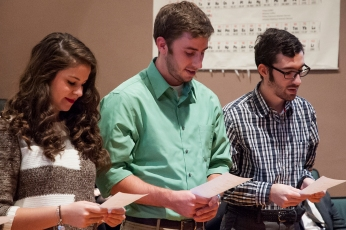 Esperanza Gutierrez, Cameron Dieck, and Paul Capoccia recite the initiation pledge. Photo credit: Paul Sevensky