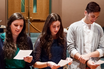 New members Haley O'Brien, Juliette Meyers, and Brandon Melo recite the initiation pledge. Photo credit: Paul Sevensky