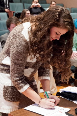 Esperanza Gutierrez signs the SCJ Honor Roll. Photo credit: Paul Sevensky