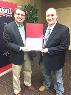 Eddie Sheehy receives his Certificate of Merit award from chatper adviser Anthony Moretti.